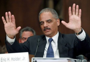 """WASHINGTON, DC - NOVEMBER 08: Attorney General Eric Holder gestures while answering questions during a Senate Judiciary Committee Hearing on Capitol Hill on November 8, 2011 in Washington, DC. The committee is hearing testimony from the Attorney General on the controversial """"Fast and Furious"""" gun-running program.  (Photo by Mark Wilson/Getty Images)"""